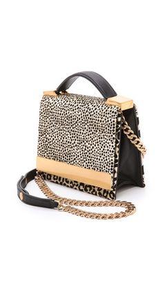 leopard print calf hair bag // love the gold hardware