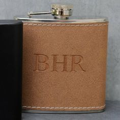 Personalized Tan Hide-Stitch Flask by Favors by Serendipity. $34.69. Holds 6 ounces. Free Engraving (we will contact you via email after you place your order). Tan hide stitched leather-like wrapped stainless steel flask. Personalize with 2 lines of up to 12 characters per line. Laser etched. Tan hide stitched leather-like wrapped stainless steel flask. Holds 6 ounces. Laser etched. Personalize with 2 lines of up to 12 characters per line.  Free Engraving (we will contact you v...