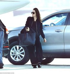 And they're off:Angelina Jolie and her children were seen looking content and refreshed a...