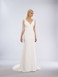 19116 - slim aline crepe v neck In Store now at I Do Bridal in Seattle, Wa. Crepe Wedding Dress, V Neck Wedding Dress, Preloved Wedding Dresses, Wedding Dresses For Sale, Classic Wedding Gowns, Designer Wedding Gowns, Bridal Sash, Bridal Gowns, Bridal Collection