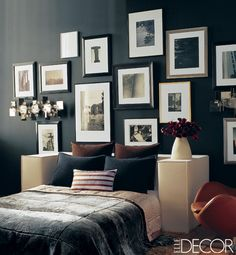 The sophisticated master bedroom of an apartment on Manhattan's Fifth Avenue features blue-chip black-and-white photographs displayed salon style on an inky wall, in addition to appropriately moody bedding. The vintage Arne Jacobsen Egg chair provides a splash of color.For more Black Rooms, visit elledecor.com