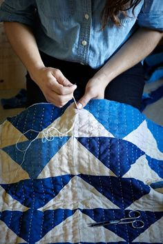 Hand quilting.