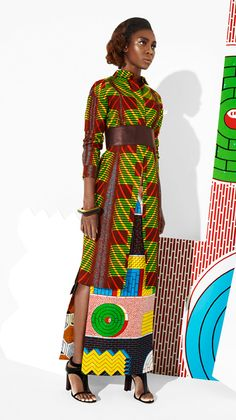 Dramatic long sleeve cheongsam inspired print dress with brown high waisted belt.  #african-print  #dress