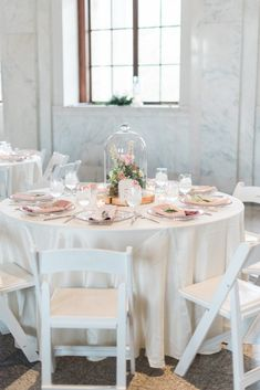 Adore this cloche centrepiece with floral design by Tulip in Atlanta! The prettiest colour palette f lush pink and white for Ian + Elizabeth's Romantic Wedding on BLOVED Blog! Captured by Holly Von Lanken Photography.
