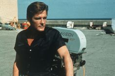 Roger Moore on location for the filming of the James Bond 007 movie 'Live and Let Die' James Bond Actors, Tony Curtis, Roger Moore, 50th Anniversary, Over The Years, The Man, Behind The Scenes, Film, Happy