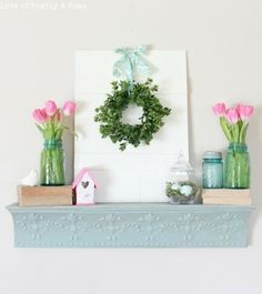 spring mantle with boxwood wreath, blue mason jars and tulips by sandyadler