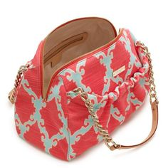 kate spade. coral + turquoise.  I have many Kate Spade handbags, I have never seen this one before anywhere, I love it!!