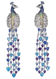 An immortal Peacock earrings from the Animal Collection. Designed as two diamond and gem-set peacocks, each with heart-shaped sapphire and alexandrite tail feathers.