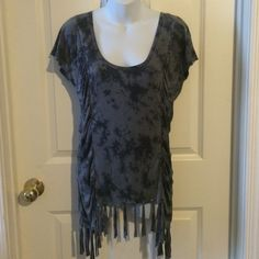 "Gray Tye Dye Fringe Tunic/Cover Great for summer days at the beach! Scoop neck and flutter sleeves. Cinching all down sides in front and back for flattering fit. Ties fringing along bottom. From shoulder top to lowest bottom point is about 30"". Sits a little higher in front bottom. Not long enough for a dress. Great gray Tye dye fabric. Cotton. Billabong Swim Coverups"