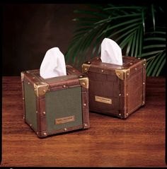 Square Tissue Box by Bauer International, handcrafted of mahogany with brass accents.    Available in Crocodile, Safari Green Canvas, & Rattan.