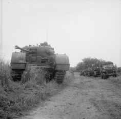 BRITISH ARMY NORMANDY 1944 (B 6002) A Churchill tank of 7th Royal Tank Regiment, 31st Tank Brigade, with jeeps and carriers during Operation 'Epsom', 26 June 1944.