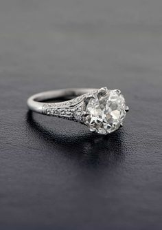 A stunning Vintage Engagement Ring, set in platinum and adorned with milgrain and filigree. A beautiful engagement ring!