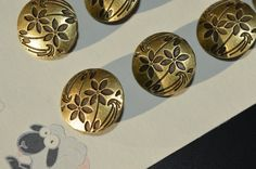 These are 12 flower bronze metal shank buttons. These buttons are 17mm or approx 3/4 in diameter. These buttons are great as an accessory to any