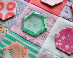 A couple of years ago at our first Quilt Market, we got a bunch of mini charm packs from Moda's booth. I wanted to use these cute little 2.5″ square stackers from the Posy line for hex…