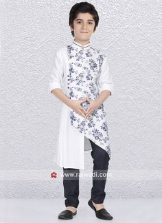 White color Linen cotton fabric kurta is designed with fancy buttons and flower print. Contrast Black color bottom comes along with this outfit. Kurta Pajama Men, Kurta Men, Kids Dress Wear, Dresses Kids Girl, Kids Dress Collection, Boys Kurta Design, Kids Wear Boys, Mens Ethnic Wear, Wedding Dresses Men Indian