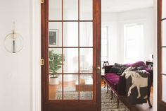 Want to create a bit of a separation between the rooms in your house, but still let light flow through? Want to add architectural interest to a boring or unremarkable space? French doors are good for that. Of course, you can use them at the boundary between your house and the outdoors, too, but french doors are especially nice when used as a interior transition between rooms. Here are a few examples to get you dreaming of adding some to your own space...
