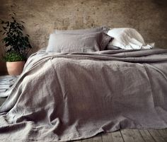 Rustic rough heavy weight linen fabric in natural flax (medium warm grey/dark oatmeal) colour has been handcrafted into beautiful large bed