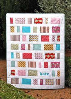 A quilt for Kate by Bloom and Blossom, via Flickr. Love the name on the front of the quilt idea