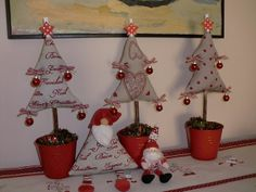 Simple fabric trees in little buckets - I love the mini ornaments hanging from the points - too cute! And the star is clipped on with a mini clothes pin.