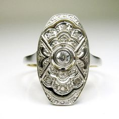 Period: Art deco (1920-1935) Composition: 18K gold and Platinum Stones: - 1 Old European cut diamond of H-SI1 quality that weighs 0.10ctw. - 6 Rose cut diamonds that weigh 0.06ctw. Ring size: 5 ¾ Ring