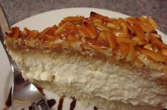 "Bienenstich Cake -- traditional German ""Bee Sting"" Cake. Sweet, chewy top and creamy filling. Yummy!"