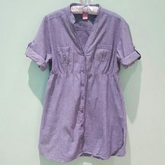 Soft Denim Shirt Dress Button up. Cuffed arm details with buttons. Fit is more like a large. Dresses