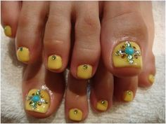 Yellow gel nail colour with bling on the toes. Pedicure looks fabulous.