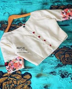 Beautiful floral embroidery Blouse Designed by Designer Blouse Ideas . Tag your picture to get featured on this page . Simple Blouse Designs, Stylish Blouse Design, Fancy Blouse Designs, Blouse Neck Designs, Nike Flex, Designer Blouse Patterns, Designer Dresses, Designer Wear, Dress Patterns
