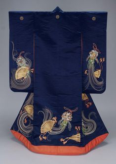 Outer robe (uchikake) with long sleeves and padded hem with design of fans and floral medecine balls (kusudama) embroidered in silk and couched with gold metallic thread on a dark blue silk satin ground; reddish-orange silk lining.