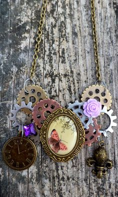 Steampunk Butterfly Cameo Necklace. Steampunk Cogs,Gears,Roses and Butterfly Cameo. on Etsy, $25.00