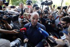 Outgoing Greek Finance Minister Yanis Varoufakis is surrounded by media as he tries to leave on his motorcycle, after his resignation in Athens, Monday, July 6, 2015. Greece and its membership in Europe's joint currency faced an uncertain future Monday, with the country under pressure to reach a bailout deal with creditors as soon as possible after Greeks resoundingly rejected the notion of more austerity in exchange for aid. (AP Photo/Petros Karadjias)
