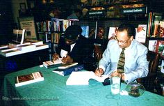 Making literary history in Savannah. The late Dr. Ja A. Jahannes (right) & Aberjhani sign copies of Encyclopedia of the Harlem Renaissance at Barnes & Noble, October 2003. (photo from Postered Poetics for Aberjhani)