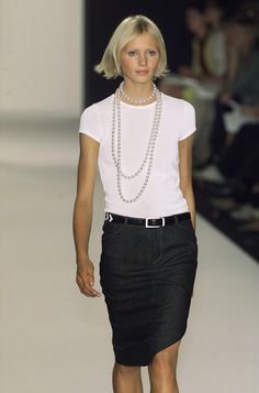 Chic that looks easy. Simple black skirt and top chic-ified with strands of pearls. #work wear. #summer. via #thedailystyle.
