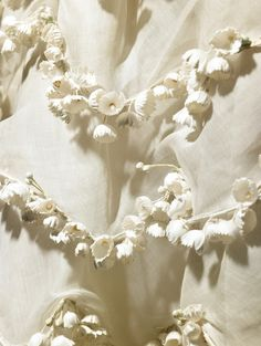 """Detail of the """"Muguet"""" dress, S/S1957. Lily of the valley was the favorite flower of Christian Dior."""