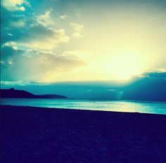 Winter sunrise over Gyllyngvase Beach and Pendennis Castle, Falmouth, Cornwall