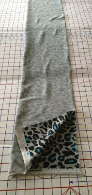 Make your own infinity scarf out of 1/2 yard of fabric. Very fast, looks great.