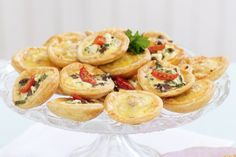 Mini Quiches Two Ways by Taste.Com.Au. These tasty little quiches make excellent finger food for Christmas entertaining.