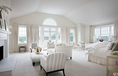 """Palladian windows are notoriously hard to curtain,"" designer Alexa Hampton says of the windows in the master bedroom of a Hamptons home she renovated for a young family. ""Either you cover them up and lose the detail or you leave them open and wake up to morning light. My client preferred to wake up to the morning light,"" said Hampton."