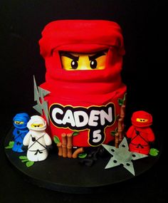 Ninjago Lego Birthday Cake Eyes And Wording Are Made From Edible Images And Figurines And Ninja Throwing Stars Made From Fondant