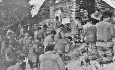 The Philippine Expeditionary Force to Korea (PEFTOK): 1950-1955: ONE OF THE FIRST TO FIGHT FOR FREEDOM / Solace in the face of death. At the foot of a sand bagged altar, the Roman Catholic men of PEFTOK attend mass at the county of Chorwon in North Korea before committing themselves to battle in the Korean War.