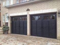 This is a beautiful custom steel insulated black garage door with a wonderful 'old world charm' and state of the art construction. It's very low maintenance and has the 3 dimensional look of its wood carriage house counterparts. Side Hinged Garage Doors, Black Garage Doors, Garage Door Hinges, Garage Door Colors, Carriage Garage Doors, Garage Door Windows, Garage Door Insulation, Modern Garage Doors, Garage Door Styles