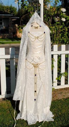 Butterfly Set    This is a great way to dress up one of our medieval gowns or sets....shown on our Lady Gwen gown and our Fairy Set. Available in silver or gold....this includes a belt with a large center butterfly.