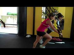 H.I.I.T. TRX Workout.  30 seconds of work, 15 seconds of rest.  5 exercises x 8 sets/circuits.  Nikki demonstrates 1 circuit of:  TRX Plyo Split Squats, TRX Reverse Row, TRX Chest Press/Knee Tuck, TRX 1-leg Burpee, TRX Diane Dips.