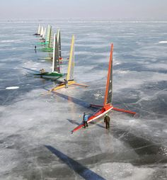 A line of Skeeters (ice boats) ready to race on Lake Winnebago in Oshkosh, Wisconsin. photo by Craig Wilson/Kite Aerial Photography