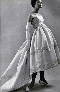 1958  Evening gown of pink faille with gold embroidered trim by Balenciaga