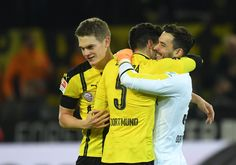 Bartra and Roman after the game against Bayern