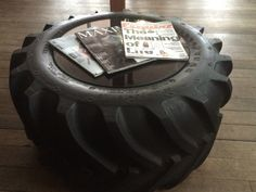 Recycled tractor tire coffee table in the waiting room at the tire shop by Spencer, the owner of Kenwood Tire #coffeetable #tire #goodyear