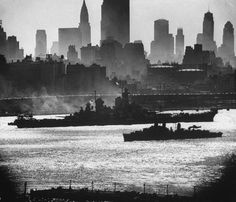16 in Iowa class battleship against the New York skyline (believed to be USS Iowa herself).