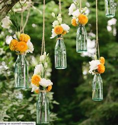 We hung flowers in glass bottles at a Goa resort wedding