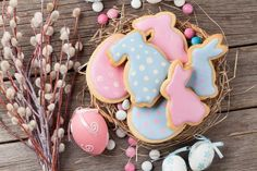 Buy Easter gingerbread cookies and eggs by karandaev on PhotoDune. Easter gingerbread cookies on wooden table. Rabbits and eggs. Easter Party, Dessert Recipes, Desserts, Gingerbread Cookies, Bunny, Food And Drink, Eggs, Sweets, Cards